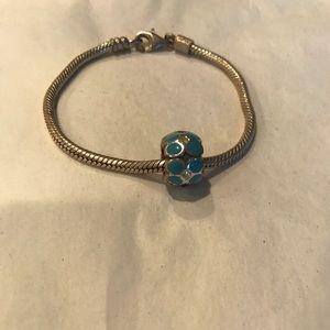 Pandora charm bracelet with blue bead